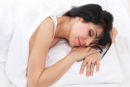Pretty mid adult woman asleep in bed Stock Photo - 12908426