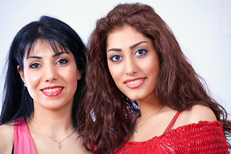 Two beautiful latina women colorful look Stock Photo - 12908530