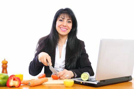 duties: Businesswoman cooking by laptop combines duties