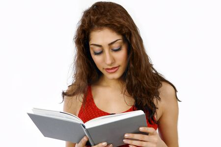 interested: Young woman reading book interested expression Stock Photo