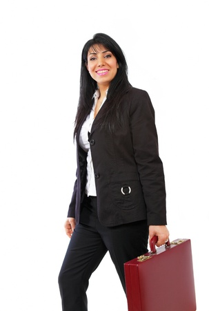 Dynamic businesswoman on the go with briefcase Stock Photo - 12981157