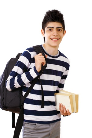 Smiling school boy with school bag and books photo