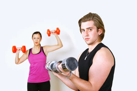 Couple exercising with focus on man photo