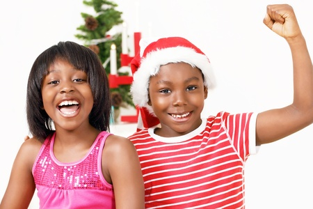 Cheering kids in the Christmas spirit Stock Photo