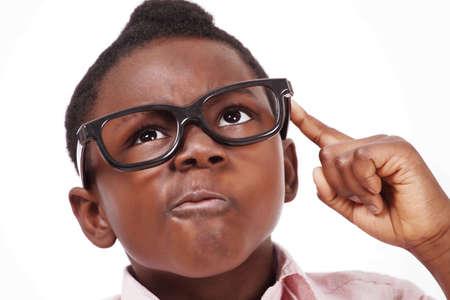 preoccupied: Scheming kid face closeup