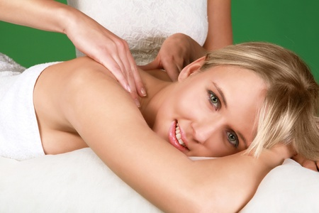 acupressure hands: Enjoying massage beautiful young woman in spa Stock Photo