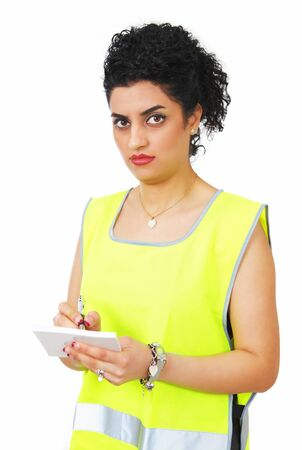 traffic warden: Traffic warden writing a ticket with strict expression