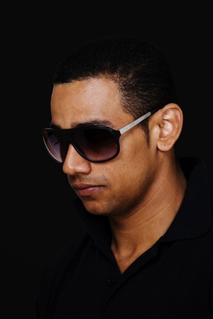 Latino male model in sunglasses on black background Stock Photo