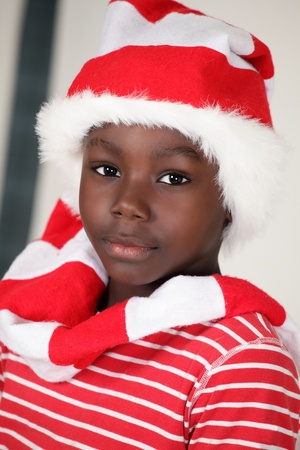 Christmas boy a cute african child in Santa cap Stock Photo