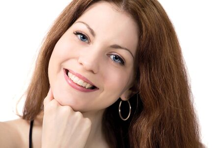 Smiling young woman with chin on hand Stock Photo - 13447199