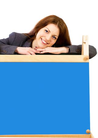 Cute smiling schoolteacher with board for your message