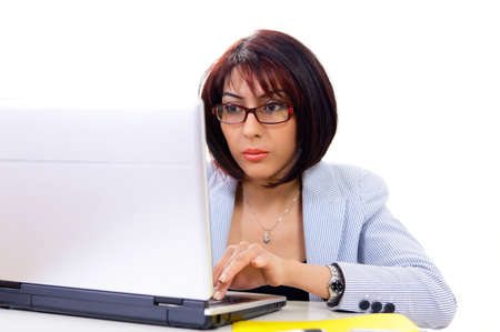 Serious mid adult professional woman busy on computer Stock Photo - 13586909