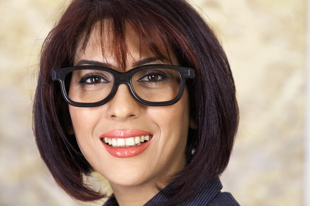 Confident smiling woman wearing spectacles