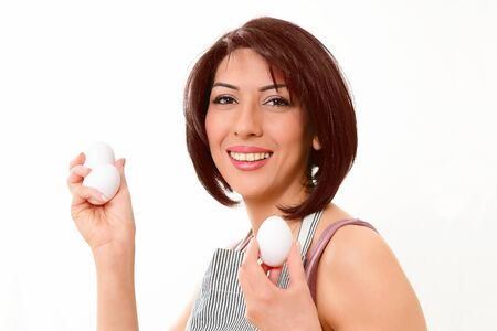 Woman with eggs, a kitchen life image Stock Photo - 13653275