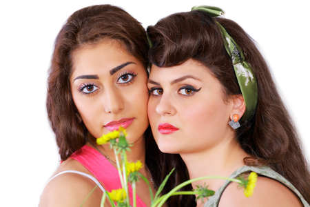 Two beautiful women with flowers Stock Photo - 13876593