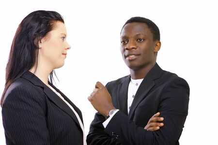 african businessman: Multiethnic business people in serious conversation
