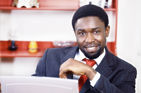 view of an elegant office: Smiling african businessman in office