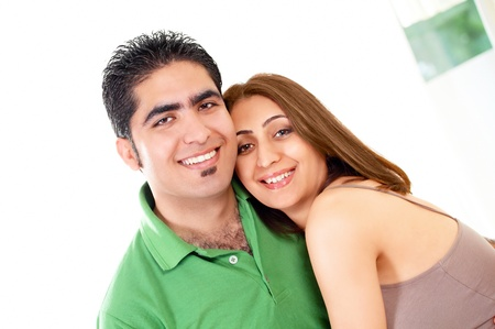affectionate actions: Happy couple embrace with cheerful smiles