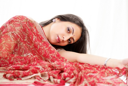 Lovely indian woman with red bridal saree photo