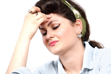 holding the head: Woman with headache or stress holding head