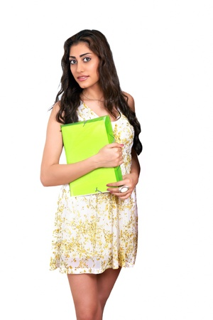 Beautiful young woman holding file photo