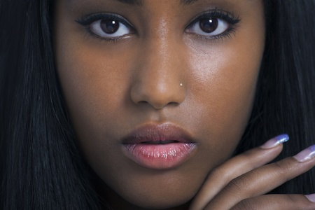 Lovely ethnic woman face closeup photo