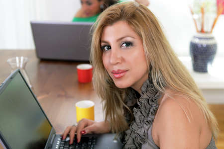 College girl on laptop in cafeteria, a campus life image photo