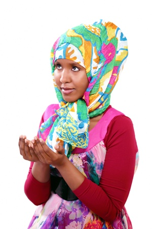 Praying woman in colorful head scarf photo