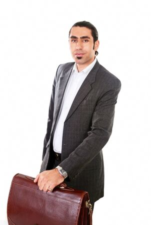 Business traveler holding red leather case photo