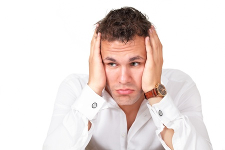 Worried man holding head Stock Photo