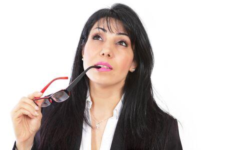 Thinking businesswoman staring upwards photo