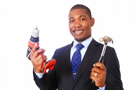 Handy businessman with hammer and drill Stock Photo - 15896702