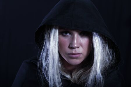 cloak and dagger: Conspirateur, a woman in black cloak Stock Photo