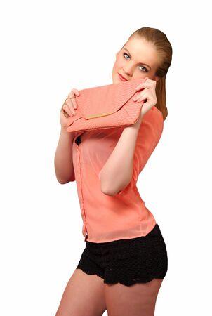 possessive: Pretty girl holding her handbag Stock Photo