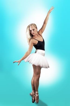 poised: Ballerina, poised and elegant in standing pose
