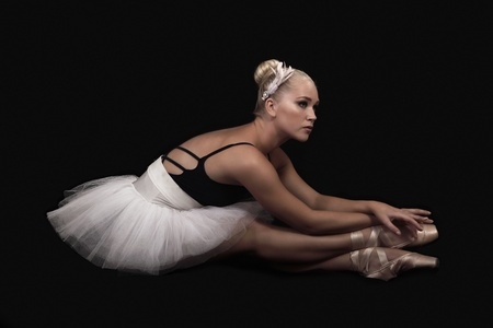 stage costume: Graceful ballerina in dance pose a side view