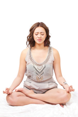holistic: Meditation, young woman in yoga lotus pose Stock Photo