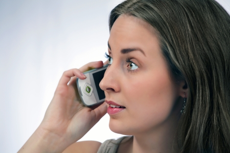 Woman on phone with serious expression