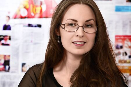 newsroom: Pretty journalist or newsroom woman in busy office Stock Photo