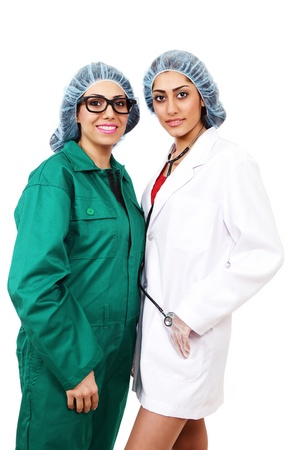 surgical gown: Surgery team with two pretty lady doctors Stock Photo