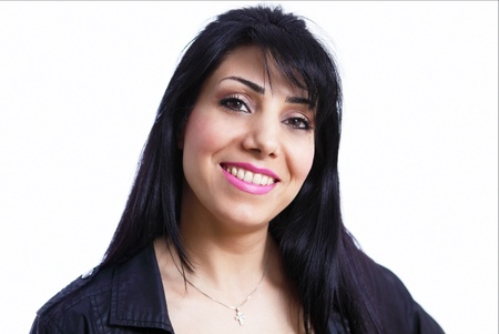 Smiling mid adult latino lady photo