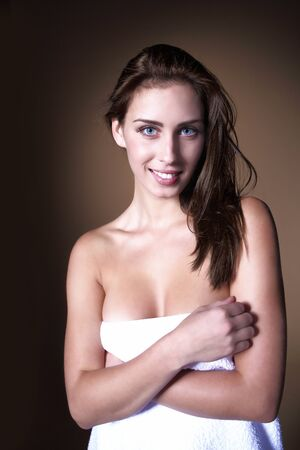 Smiling young woman in white towel Stock Photo - 17053872