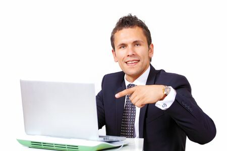 Handsome businessman pointing to computer Stock Photo - 17077054