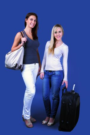 Happy traveling girls on blue background Stock Photo - 17124964