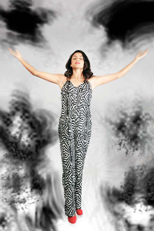 heaven and hell: Modern woman on turbulent religious path Stock Photo