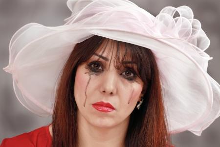 tearful: Tearful widow, a horizontal portrait