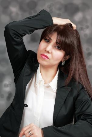 holding the head: Stress of job loss, woman holding head