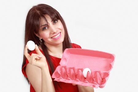 hen's: Smiling lady with egg and egg-tray