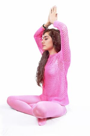 Meditating woman all in pink photo