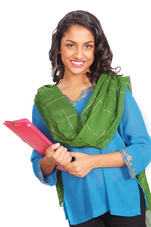 Pretty indian student with file in traditional clothes photo